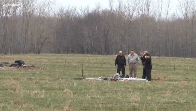 Officials check a helicopter that crashed in Gaines, Orleans County, on Tuesday, April 24, 2018.