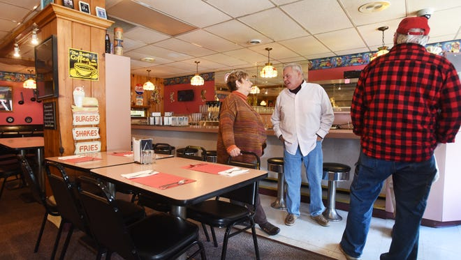 Owner Jennifer Estep chats with visitors to Nichol's Diner on Thursday. The restaurant and all its furnishings goes up for auction on Thursday, Nov. 9.