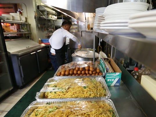 Korean restaurant cooks for homeless