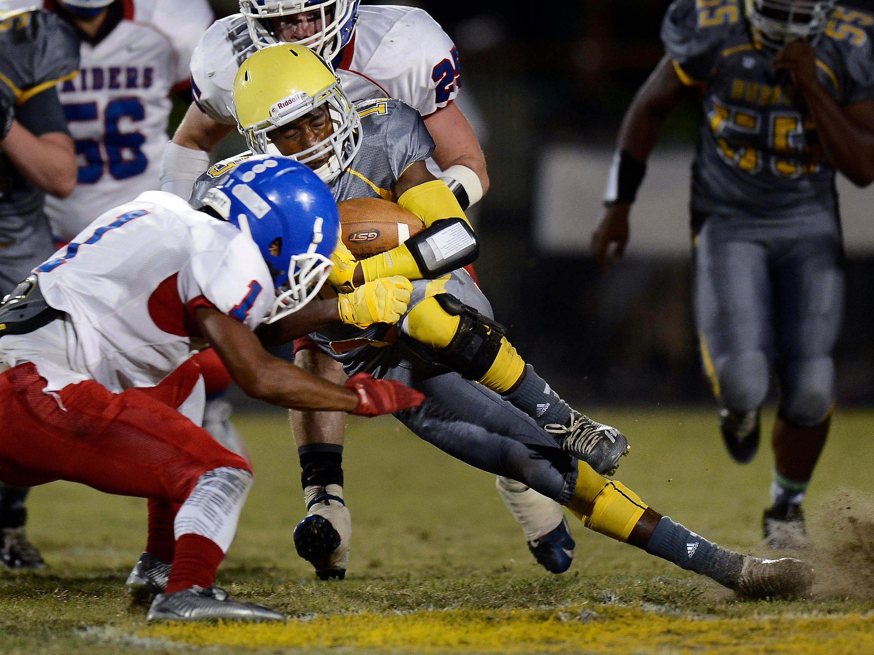 Hillsboro back and University of Tennessee commit Vincent Perry (13) has helped the Burros to an unbeaten mark thus far.