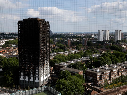 The remains of Grenfell Tower stand in London on June