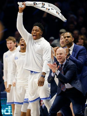 The Xavier Musketeers bench celebrates after drawing a foul in the first half of the NCAA Big East Conference basketball game between the Xavier Musketeers and the Creighton Bluejays at the Cintas Center in Cincinnati on Saturday, Jan. 13, 2018.