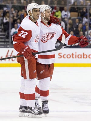 Andreas Athanasiou (72) and Mike Green celebrate after a goal against Toronto on Saturday.