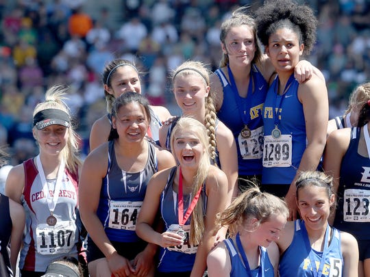 Olympic's 4x100 meter relay team celebrates winning silver medals at the state track and field championships Saturday at Mount Tahoma High School in Tacoma. The team included Morgan McCorkle, Danielle Monzon, Stephanie Barr and Hanna Troy.