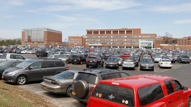 As the University of Rochester has grown and expanded, so too has the need for parking in massive lots like Lot 2 at the University of Rochester Medical Center, seen Monday, April 21, 2014 off Lattimore Rd in Rochester.