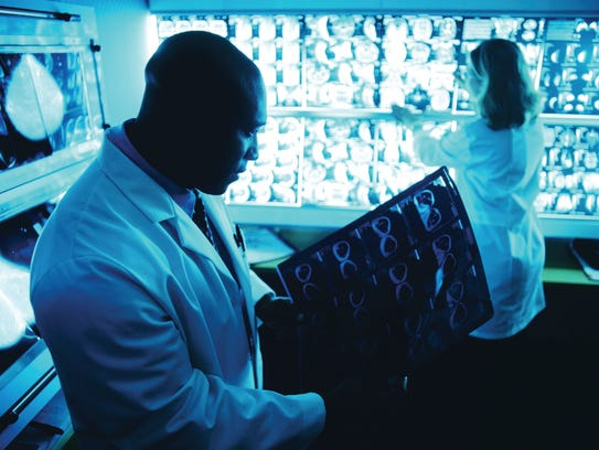 Physicians examine test results.
