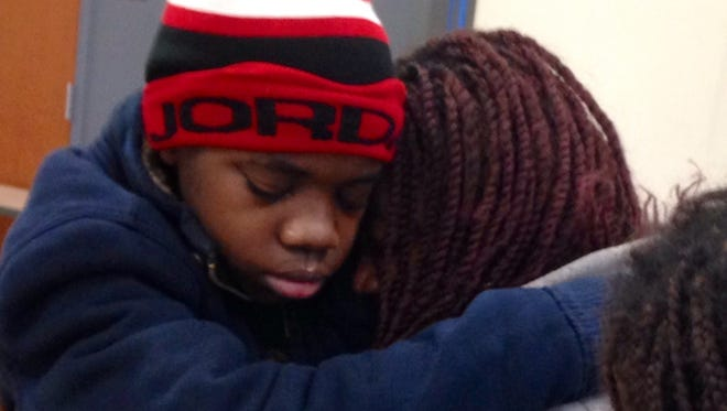 The missing boy is reunited with his mother early Saturday.