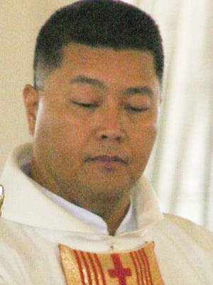 Father Raymond Cepeda is shown in this June 5, 2004 file photo.
