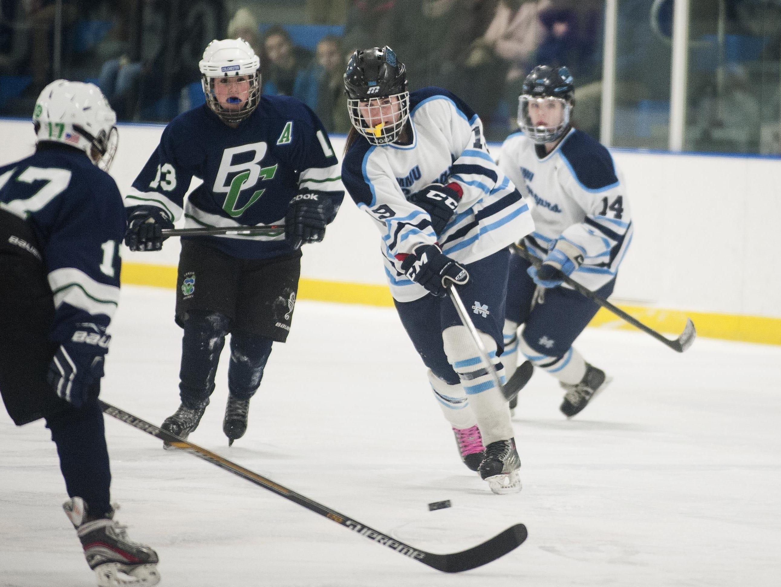 MMU's Anna Burke (19) takes a shot during a girl playoff hockey game last season.