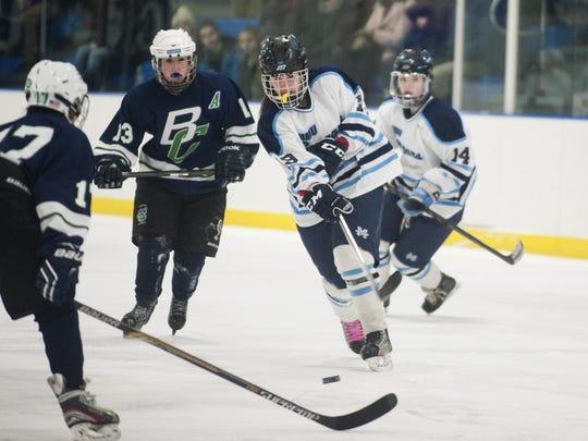 MMU's Anna Burke (19) takes a shot during a girl playoff