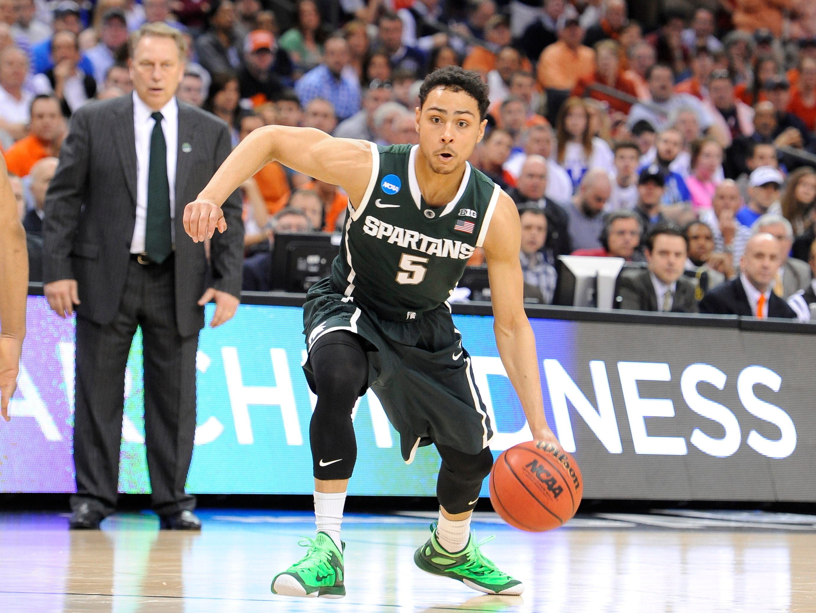MSU's Bryn forbes heads to the hoop as Tom Izzo watches against Virginia during their NCAA game in Charlotte, NC Sunday 3/22/2015.