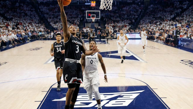 Cincinnati Bearcats guard Justin Jenifer (3) breaks away for a layup in the second half of the 85th Annual Crosstown Shootout game between the Xavier Musketeers and the Cincinnati Bearcats at the Cintas Center in Cincinnati on Saturday, Dec. 2, 2017. The Musketeers won't the annual crosstown rivalry game, 89-76, dealing UC its first loss of the season.