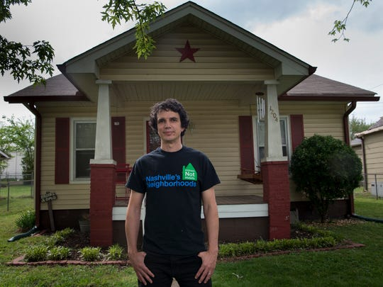 Omid Yamini stands outside his home in the Cleveland