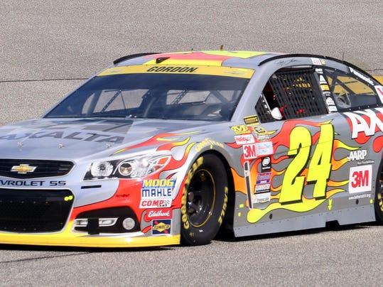 Jeff Gordon (24) takes turn four during the NASCAR Sprint Cup Series auto racing practice Friday, Nov. 20, 2015, at Homestead-Miami Speedway in Homestead, Fla. (AP Photo/Jim  Topper)