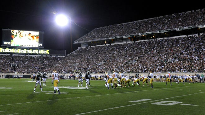 MSU takes on Notre Dame under portable lights in 2012. The school's Board of Trustees approved permanent lighting for Spartan Stadium, which is expected to be ready for the 2017 season.