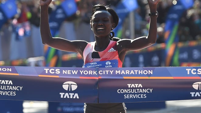 Mary Keitany of Kenya crosses the finish line to win the Women's Division during the New York City Marathon November 6, 2016 in New York.