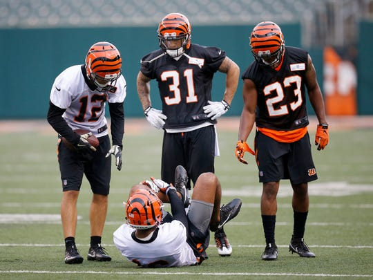 Cincinnati Bengals wide receiver Cody Core (16) clutches his left leg as he goes down injured after the final play of practice during the team's mini camp inside Paul Brown Stadium in downtown Cincinnati on Wednesday, June 14, 2017.