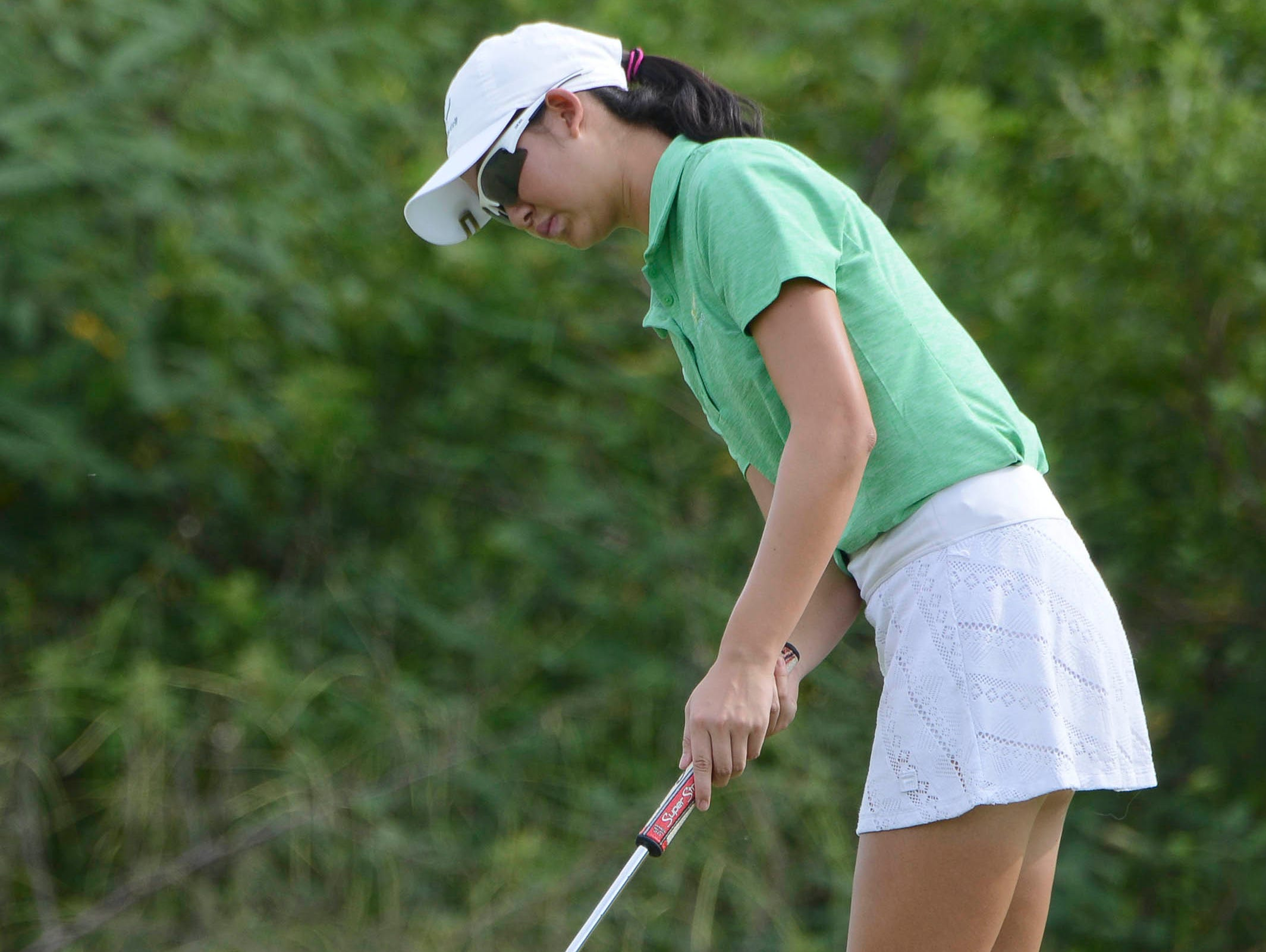 Sophie Liu of Viera putts during Thursday's match against Heritage at Baytree National.