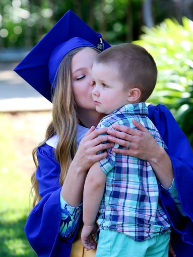 Megan Peebles kisses her nephew Kayden Barton on the