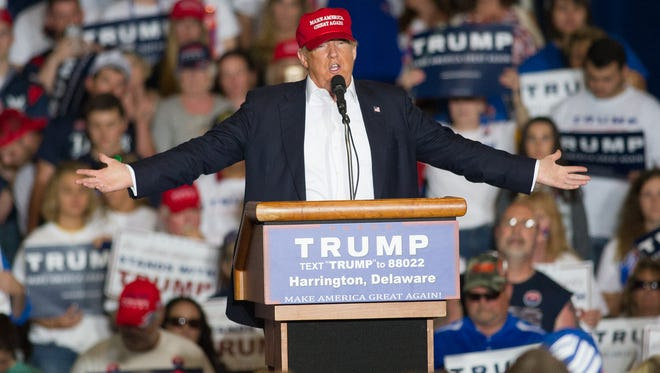 Donald Trump takes part in a rally in Harrington on April 22. calling for mass deportation of people living in the country illegally have been. A mainstay at Trump campaign rallies during the past year.