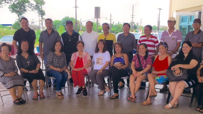 Manaoag Family Association of Guam, a non-profit group had their first General Membership Meeting at the Guam Farmer's Market in Dededo on July 16. Pictured seated from left: Tita Alegria, Nelly Calimlim, Elma Marquez, Lucie Marquez, Lynn Apilado-Manibusan, Linda Simon, Cecil Marquez, Violeta Tinoso, Charlene Mayo and Julie Paet. Pictured standing from left: Vic Gaza, Efren Marquez (Interim President), Dan Ferguson, Juanito Marquez, Ben Sales, Rudy Marquez, Timothy Rebugio, Vic Apresto and Rolly Marquez. Meetings scheduled every forth Sunday. Contact: 486-8744