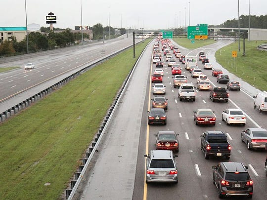 People drive out of the Orlando area in Kissimmee,