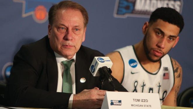 Coach Tom Izzo and star Denzel Valentine speak during an emotional news conference after MSU's 90-81 loss to Middle Tennessee State on Friday.