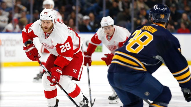 Red Wings center Steve Ott (29) prepares to shoot the puck as Sabres defenseman Taylor Fedun (38) defends during the first period Wednesday in Buffalo, N.Y.