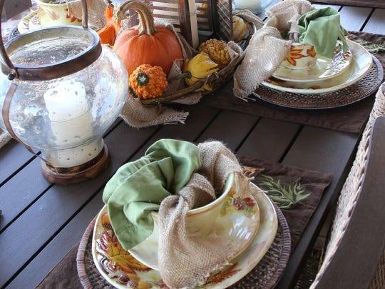 "If you are wanting to set a fall table, whether you have fall dishes or not, you can still create a beautiful table. Start with a fall colored place mat. Purchase a roll of burlap ribbon that is about 6"" wide from the craft store. Cut the burlap into 16"" pieces and tie a not in the middle. Then place the burlap next to your dinner plate, or inside of a serving bowl along with a fall colored napkin."