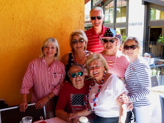 John and Pat Rowe, of Dallas, their family and friends are among long-time reservation holders at Pepi's on July 4: Ingrid Gass (front row, from far right), John Rowe, Pat Brady, Pat Rowe, Greg Terry, Jacqueline Fojtasek, Carolyn Terry.