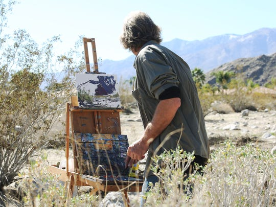 Painter Terry Masters paints the San Jacinto Mountains