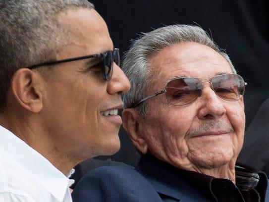 Former President Barack Obama (left) and Cuban President