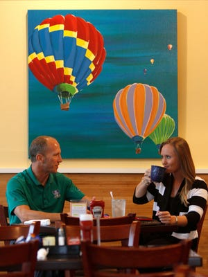 Sam Moreland and Cassie Puhl discuss their love of the water at Poached in Bonita Springs.