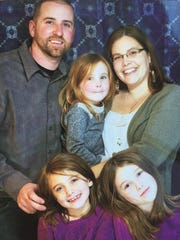 Heidi and Brendon Cousino pose with their three daughters, Sophia, 8, Liliana, 6, and Amelia, 4. Brendon Cousino was killed Thursday night in a three-vehicle crash on I-89 in Richmond.