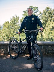 Burlington police Chief Brandon del Pozo poses with one of the new bicycles from Budnitz Bicycles on which officers will patrol.