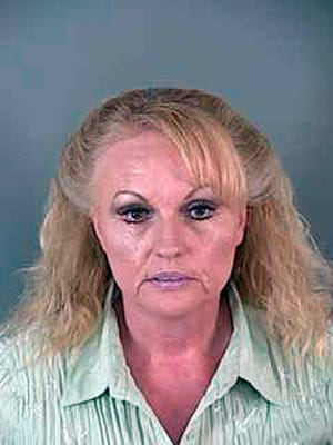 This undated file photo provided by Lane County Corrections shows Pamela Gygi. On Wednesday, May 3, 2017, Gygi was sentenced in Eugene, Ore., to 10 years in federal prison for a murder-for-hire scheme that unraveled when the felon she hired to kill her ex-husband drove to Utah and alerted him to the plot.