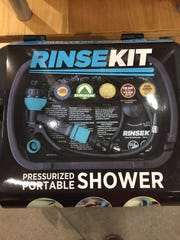 A RinseKit portable shower at the Fort Collins REI store.
