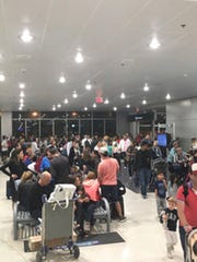 This photo provided by Shawn Woodward shows the scene from the Miami Airport, Thursday, Sept. 7, 2017. Police said they were investigating an officer-involved shooting Thursday night at the Miami airport that shut down a terminal as people looked to leave Florida ahead of Hurricane Irma. Police said in a statement that they were responding, but no other details were immediately available.
