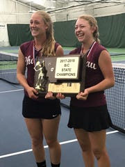 Choteau's Michaela Gunderson (left) and Christine Funk, posing with the 2018 State Class BC team trophy, joined forces and won the doubles' crown while helping the Bulldogs finish tied for third in the team event.