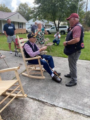 Louis Graziano, sitting down, talking to a Patriot Guard Rider during the parade in Thomson.