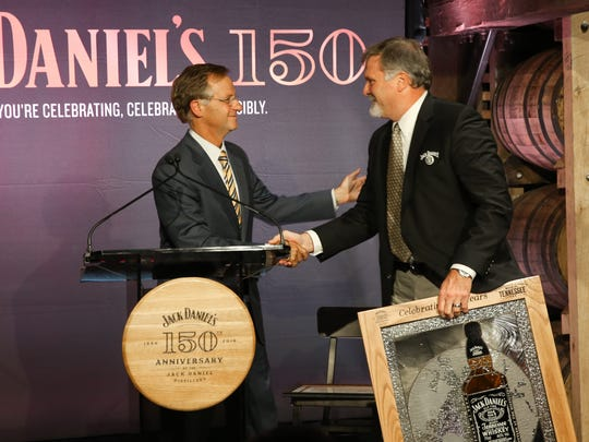 Gov. Bill Haslam and Jack Daniel's Master Distiller Jeff Arnett participate in a ribbon- cutting ceremony Wednesday, July 13, 2016.