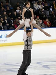Jacob Nussle does a lift with partner Cora DeWyre at