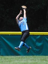 Delaware District 3 center fielder Taylor Collins snags