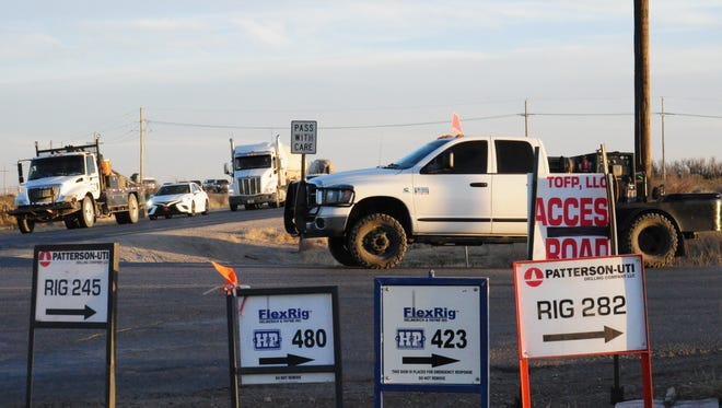 Signs on County Road 716, also known as Higby Hole Road, point the way to drilling rigs. U.S. Highway 285 which intersects with CR 716 runs south into Malaga, New Mexico where residents say heavy industrial traffic is making life difficult.