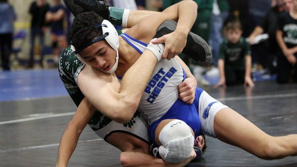 Port Chester's Ivan Garcia on his way to defeating Pleasantville's Len Balducci in the 106-pound weight class at the Westchester County Wrestling Championship at Yonkers High School Jan. 20, 2018.
