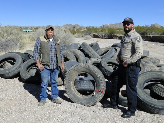 Recently dumped tires are seen here in an arroyo near Doña Ana; pecan farmer Tom Chavez reported the illegal dumping and Codes Enforcement Officer Kevin Apodaca responded to gather evidence and document the site.