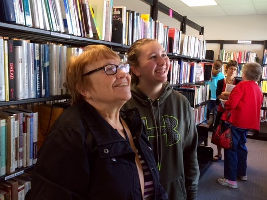 Browsing for books at the grand opening of Chapter 52 on Sept 12 are Nancy Kinter of Waterloo, Iowa and her granddaughter Grace Kjer of Kewaskum.