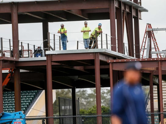 Construction workers take a break by watching Tigers