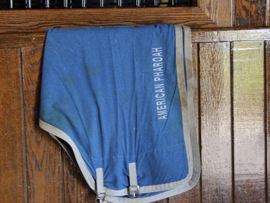One of American Pharoah's blankets at his stall at