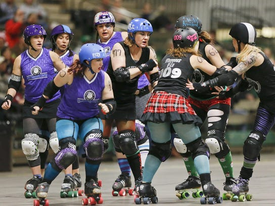The Electric City Roller GrrrlZ take on Kalispell Saturday at the Four Seasons Arena.